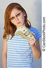 Child with money - girl holding 20 dollar bills