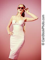 fashion pink - Glamorous young woman wearing elegant fitting...