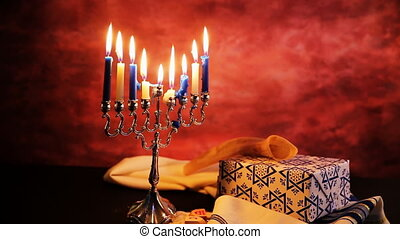jewish holiday Hanukkah with menorah over wooden table...