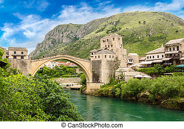 The Old Bridge in Mostar in a beautiful summer day, Bosnia...