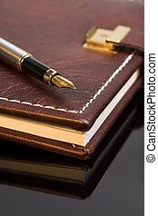Diary - Pen on a closed diary