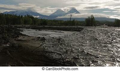 River Studenaya and Kluchevskaya group of volcanoes at dawn....