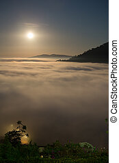 moon and fog in the morning with mountain at Khao Kho, Thailand