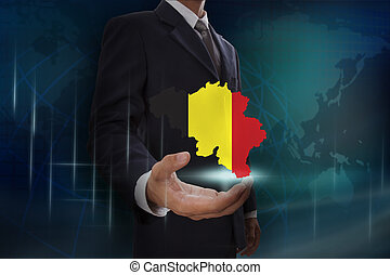 Businessman showing map of Belgium on globe background