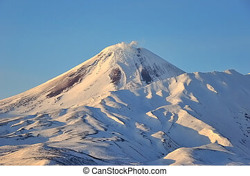 Winter view of eruption active Volcano - Kamchatka: winter...