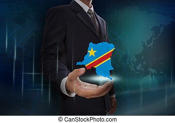 Businessman showing map of Democratic Republic of the Congo...