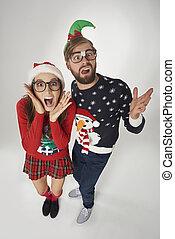 Shocked couple on grey background