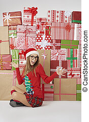 Woman and stack of Christmas presents