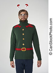 Cheerful man and Christmas cardigan