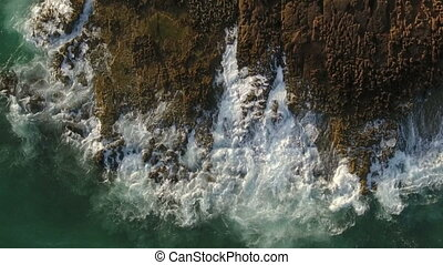 Aerial. Waves and sea splashes in slow motion, as seen from...