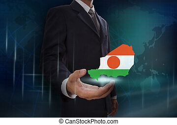 Businessman showing map of Niger on globe background