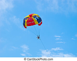 Parasailing in the deeep blue sky