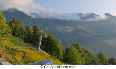 The slopes of the mountains at sunset. Rosa Khutor, Sochi,...