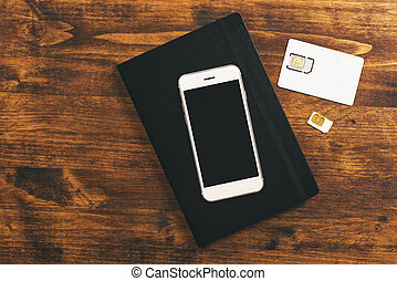 Switching SIM cards in mobile smartphone - Switching SIM...