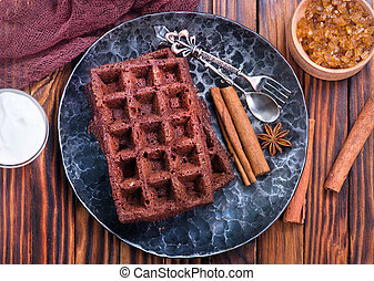 chocolate wafer on plate and on a table
