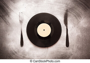 Good taste in music - Vinyl record in the form of plates on...