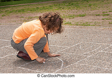 Hopscotch - Little girl drawing squares on the street, for...