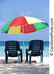 Two chairs and umbrella on tropical beach, venezuela