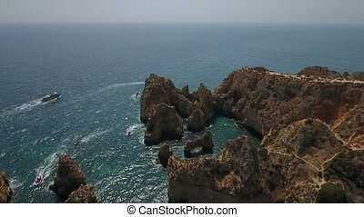 Aerial. Flight and video shooting over the Cape Ponta de...