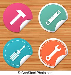 Screwdriver and bubble level, hammer. - Round stickers or...