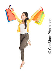 Happy Asian woman with shopping bags - Happy young Asian...