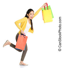 Asian woman shopping - Happy young Asian female shopper...