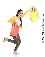 Asian woman with shopping bags - Happy young Asian woman...