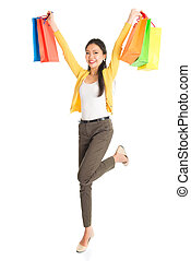 Happy Asian female with shopping bags - Happy young Asian...