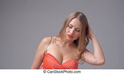 blond woman looking at camera - seductive blond woman...