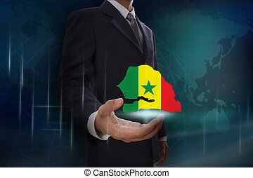 Businessman showing map of Senegal on globe background