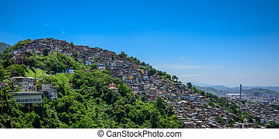 View from Mirante Dona Marta to the hill of the slum, favela...