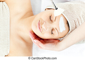 Beautiful relaxed woman receiving a beauty treatment in a...