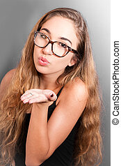 Beautiful young woman send a kiss