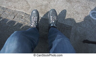 legs that swing on the floor - legs in blue jeans, which...