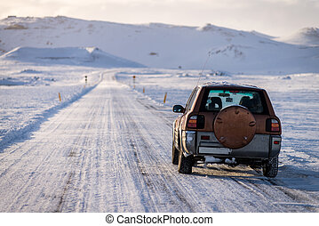 SUV car on the empty road in Iceland - Empty road in Iceland...