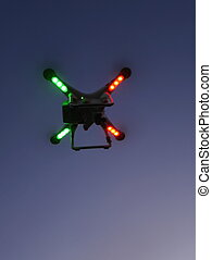 Drone with green and red signal lights from below. - View on...