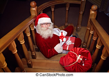 New Year s Eve - Santa Claus sitting on staircase and...