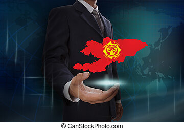 Businessman showing map of Kyrgyzstan on globe background