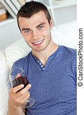 young man with a glass of wine
