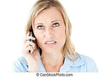 Frustrated businesswoman talking on phone against white...