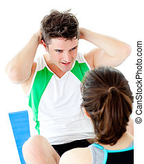 Handsome man doing fitness exercises with a woman
