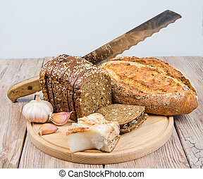 rye bread with bacon and garlic on a cutting board