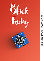 black friday and gift box on color background