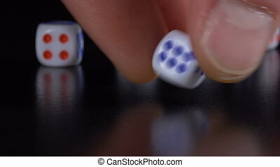 Dice throw on a black table - White dice throw on a black...