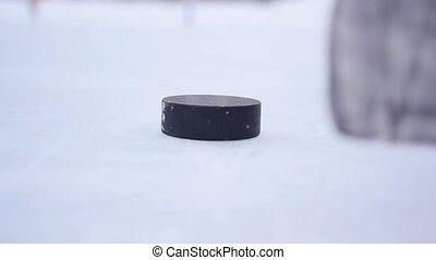 Slow Motion Hockey - player shot a stick on the puck closeup