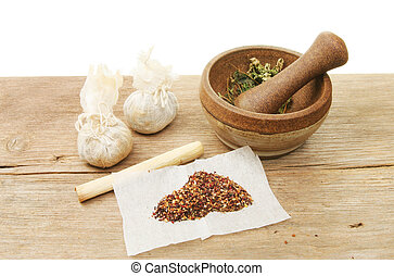 Preparing herbs - Herbal preparation and ingredients on a...