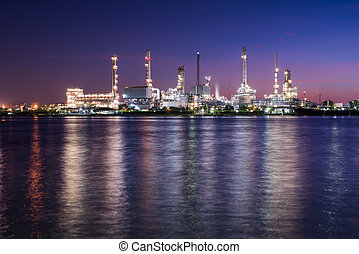 oil and gas refinery petrochemical factory at twilight
