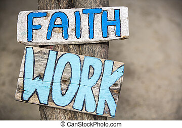 Faith and work wooden signs on tree trunk in Mancora, Peru -...