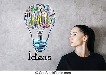 Successful idea concept - Attractive young woman looking at...