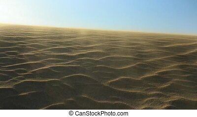 wind blowing on a desert sandy dune